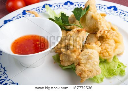 Fried chicken fingers with spicy chili sauce