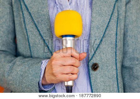 Journalist holding microphone. Media reporting. Journalism. News.
