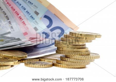 money euro coints and banknotes on white background