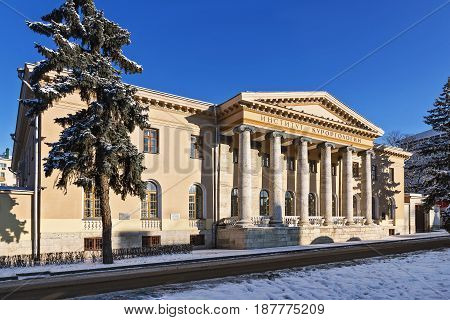 The old building in Pyatigorsk in the classical style with the inscription on the portico