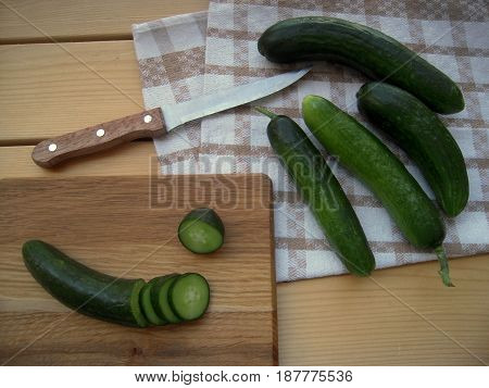 Cucumbers chopped, on the kitchen towel, the best food for diet, healthy food.