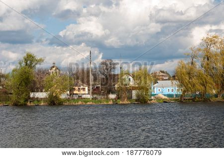 The structure of the small river rural landscape. cloudy skies. inwardness