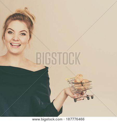 Woman Hand Holding Shopping Cart With Sweet Bun
