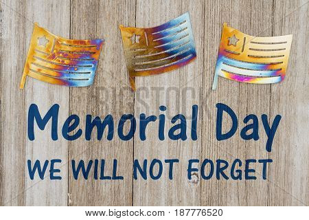 Memorial Day We will not forget text with USA patriotic old metal flags on a weathered wood