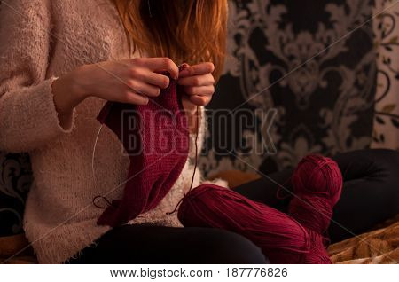 Close-up of hands knitting girl hands Hobby background