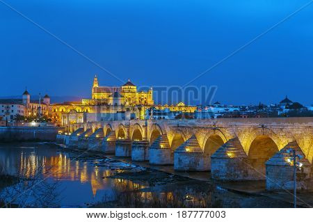 The Roman bridge and Guadalquivir river in the Historic centre of Cordoba Andalusia Spain. Evening
