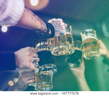 Group of people celebrate party with beer