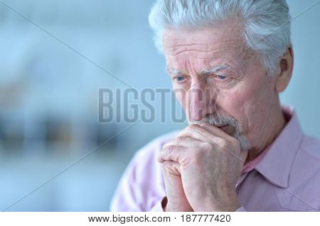Portrait of a sad elderly man closeup