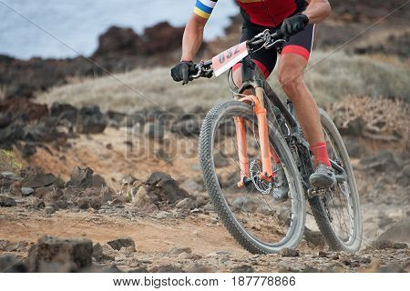 Extreme mountain bike sport athlete man riding outdoors,bike on the rocky trail