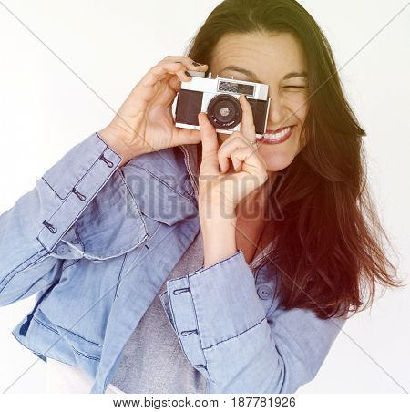 Woman photographer holding camera and focusing