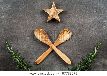 Wooden fork and spoon on dark background