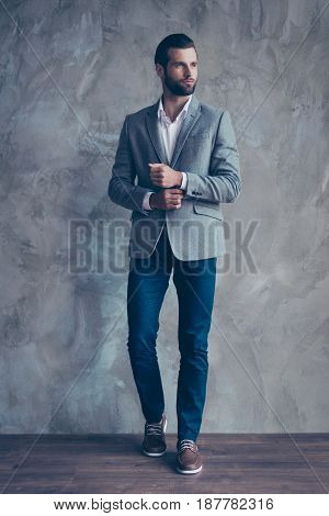 Full Size Portrait Of Stylish Young Bearded Man Standing On Gray Background. He Looks Stunning! In A