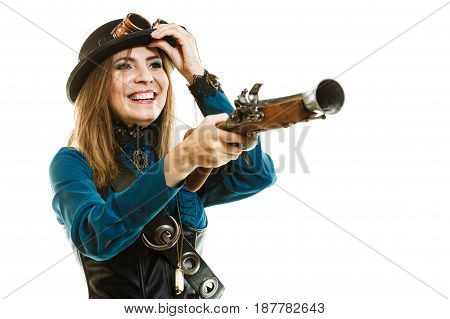 Young steampunk islolated girl on white wearing fancy hat having fun. Fantasy old fashion with stylish bowler goggle and gun aiming.