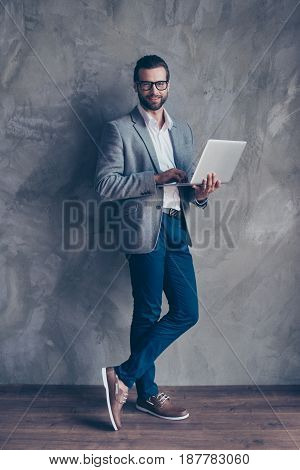 Full Length Of Cheerful  Bearded Business Man In Formal Wear And Glasses, Typing On His Laptop, He I