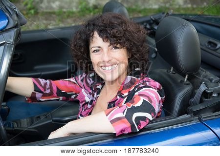 Mature Woman Sitting In A Convertible Car