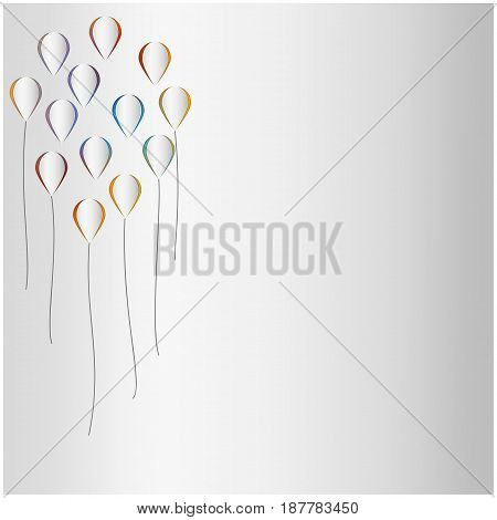 Colorful cutout baloons on white paper background