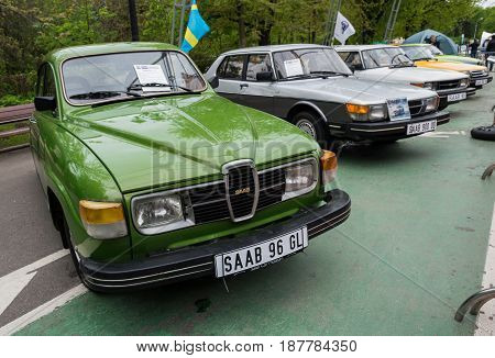 MOSCOW, RUSSIA - May 21, 2017. Retro car show exhibion in Sokolniki park. Saab 96 GL and entire line up of SAAB