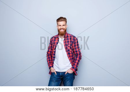 Success Concept. Excited Young Stylish Red Bearded Student In Bright Casual Shirt And Jeans On Pure