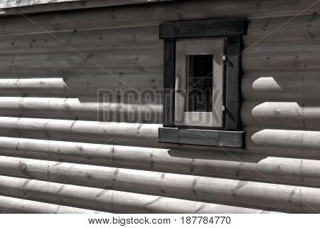 Wooden house from calibrated logs of brown color