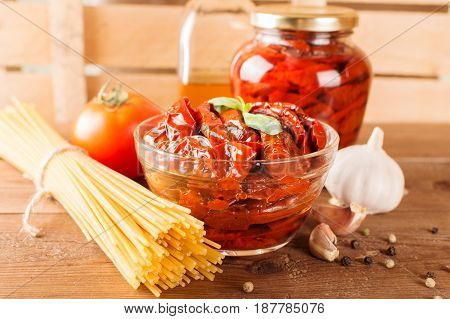 Italian Spaghetti With Ingredients For Cooking Pasta On A Wooden Table