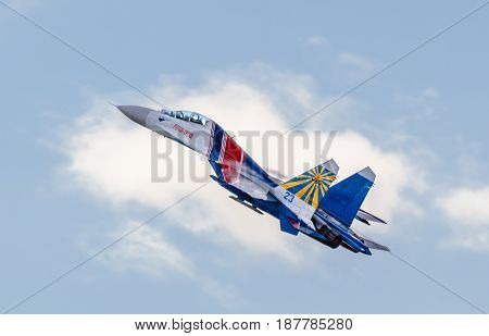 Russia, St. Petersburg - July 11, 2015. The su-27 from the aerobatic team Russian Knights gains altitude in Airshow