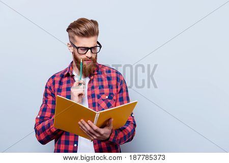 So Nerd And Stylish. Young Red Bearded Handsome Student Is Concentrated On Studying. He Is In A Casu