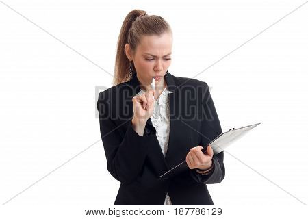 serious sexy business woman holds the handle near the mouth and looks into the Tablet is isolated on a white background close-up