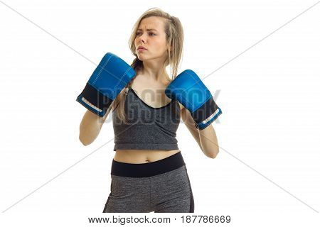 a charming young blonde-athlete stands in grey suit thoughtfully looks away - Boxer isolated on a white background