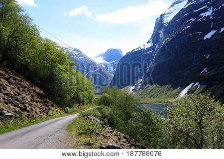 The Narrow And Winding Road Leads Into The Glacier In Loen, Stryn.