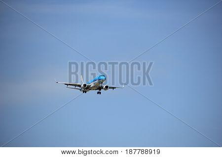 Amsterdam the Netherlands - July 21st 2016: PH-EZF KLM Cityhopper Embraer ERJ-190STD approaching Polderbaan runway at Schiphol Amsterdam Airport arriving from Aberdeen United Kingdom