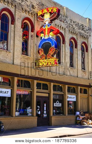 Nashville, TN, USA - 04/05/2015: Hats and Boots store neon sign on 3rd Street S in downtown Nashville Tennessee