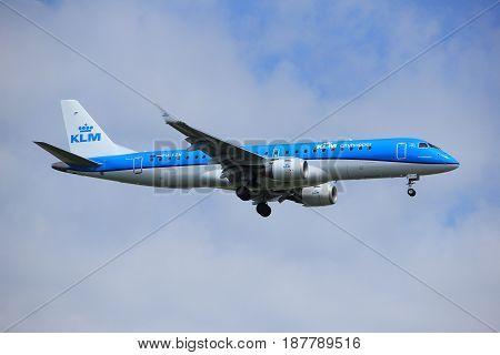 Amsterdam the Netherlands - July 21st 2016: PH-EZN KLM Cityhopper Embraer ERJ-190STD approaching Polderbaan runway at Schiphol Amsterdam Airport arriving from Bilbao Spain