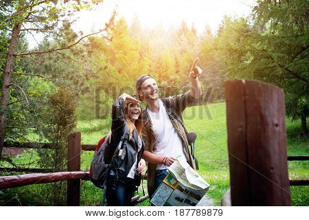 Young couple traveling in a nature. Happy people. Travel lifestyle