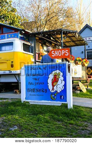 Nashville, TN, USA - 04/04/2015: I Dream of Weenie hot dogs served from a walk-up window in a vintage VW bus on 11th street in East Nashville