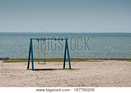 The Swing On The Empty Beach
