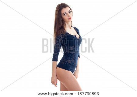 sexy wonderful girl in the lace Bodysuit stands sideways in front of the camera back stretched isolated on white background