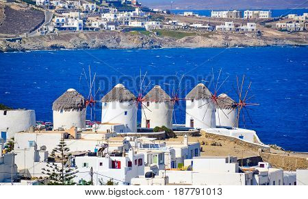 Two of the famous windmills in Mykonos Greece during a clear and bright summer