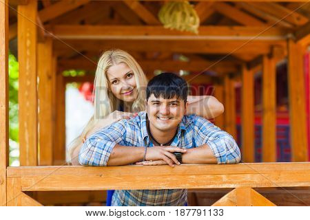 Happy loving couple. Portrait of beautiful young couple bonding to each other and smiling while both standing outdoors.
