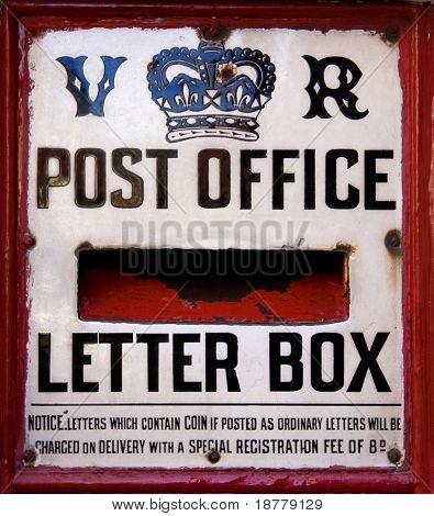 A close up of a Victorian post box