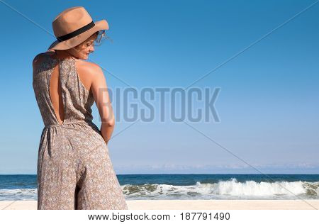 Young beautiful female enjoying sunny day on beach