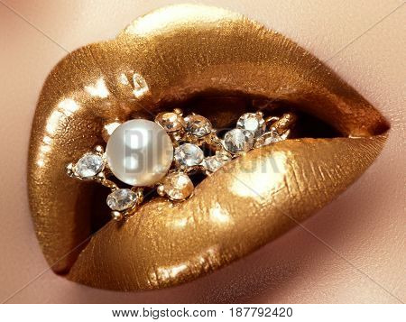 Cosmetics And Make-up. Closeup Of Gold Artistic Lips. Glitter Shiny Lip Makeup. Shoot Of A Beautiful
