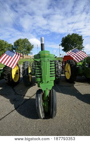 YANKTON, SOUTH DAKOTA, August 19, 2106: The restored   John Deere tractor decorated with USA flags is displayed at the annual Riverboat Days celebrated the third weekend of August in Yankton.
