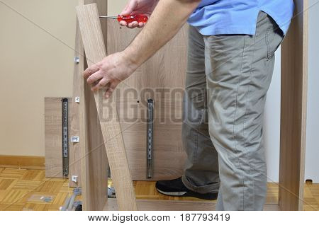 Screwing Elements Of Furniture