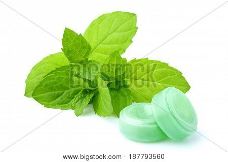 Candies for the throat with sprig of mint isolated on a white background.