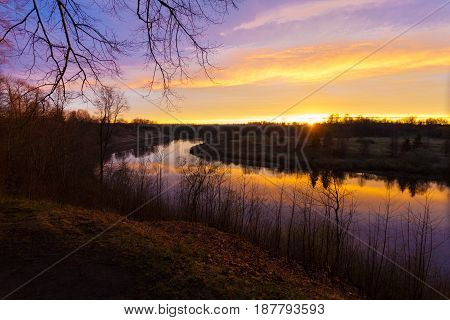 Spring. river. sunrise. sunset. Dawn over the river photographed in early spring