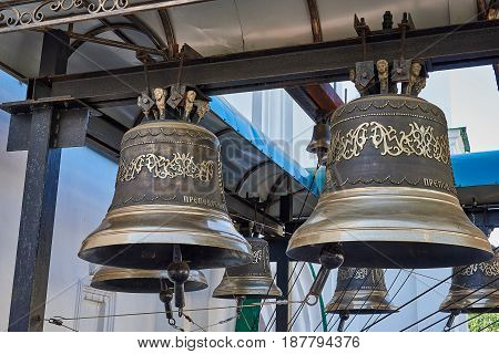 Bells with a beautiful ornament. Bells hung on a metal beam. Theodosius Pechersky Church (belongs to the Ukrainian Orthodox Church) built late seventeenth century