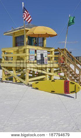 yellow life guard shack on Siesta Beach Florida