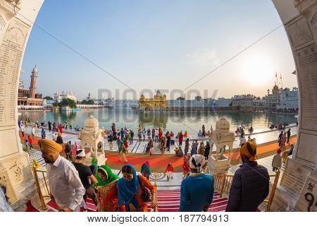 Tourists And Worshipper Walking Inside The Golden Temple Complex At Amritsar, Punjab, India, The Mos