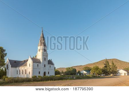 NIEU BETHESDA SOUTH AFRICA - MARCH 22 2017: Early morning street scene at the Dutch Reformed Church in Nieu-Bethesda an historic village in the Eastern Cape Province. The church was built in 1905