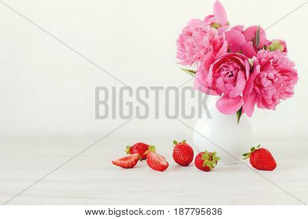 Still life with pink peonies and strawberries